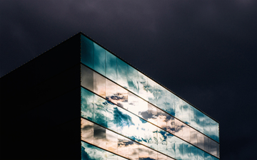 Cloudy_sky_reflected_on_glass_building_21_s.jpg