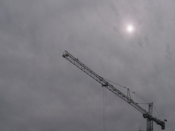 Sun_screened_by_clouds_and_crane_2.jpg