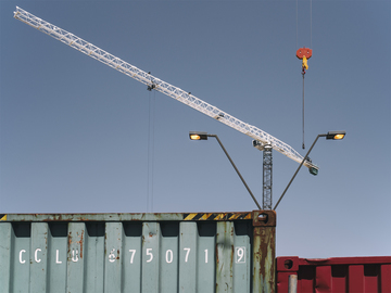Two_Tower_Cranes_Shipping_Containers_Streetlight_at_Noon.jpg