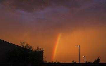 Desert_Rainbow_Against_Orange_Sky.jpg