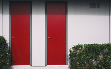 Red_Doors_Green_Bushes.jpg