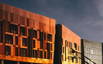 Copper_Building_Sunrise_Light_Reflection_Boom_Lift_02-1.jpg